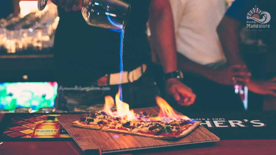 Chilli Cheese Rum Flaming Pizza - ONYX Air Lounge & Kitchen - MG Road, Mangalore